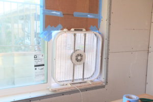 box fan in window for dust containment