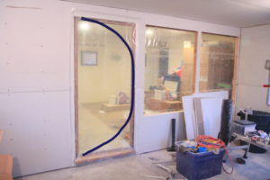 dust containment door guard