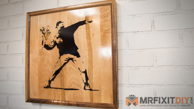 wooden banksy wall art