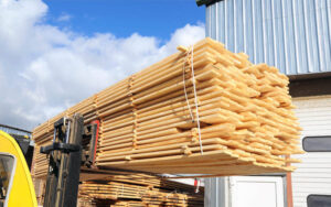 building lumber supplies on forklift at lumberyard