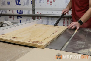 breaking down plywood on the table saw cordless power tool storage shelf
